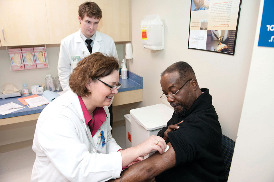 Patient receives care at a SLU health clinic.