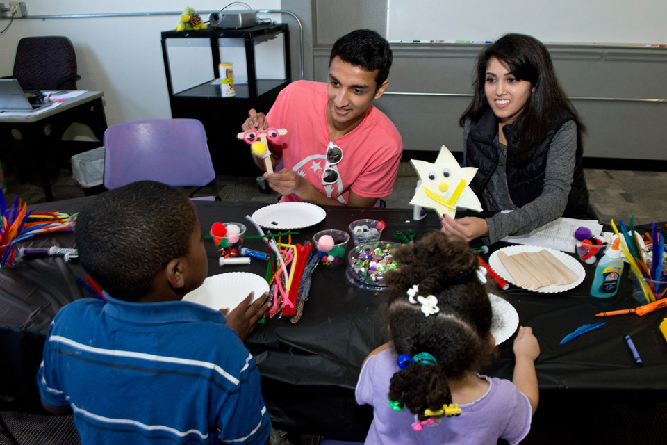 Students crafting with children